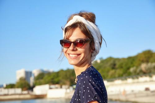 smiling woman at coastline